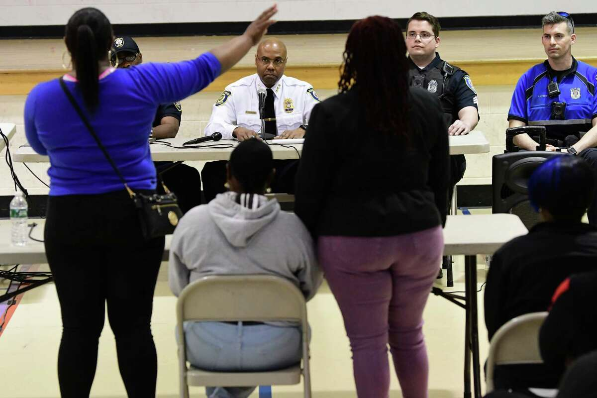 Gloria Stanford, sister of victim Armando Sanchez, left, expresses her concerns to Police Chief Eric Hawkins, center, during a community meeting focusing on allegations police brutalized residents of First Street after being called to address complaints about noise on Monday, April 22, 2019 in Albany, N.Y. Stanford's mom Sandra Thompson sits next to her. (Lori Van Buren/Times Union)