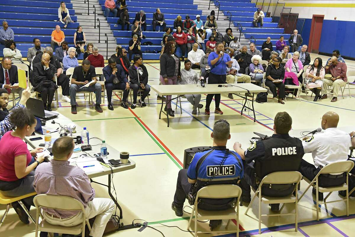 Gloria Stanford, sister of victim Armando Sanchez, expresses her concerns to Police Chief Eric Hawkins, right, during a community meeting focusing on allegations police brutalized residents of First Street after being called to address complaints about noise on Monday, April 22, 2019 in Albany, N.Y. Stanford's mom Sandra Thompson sits next to her. (Lori Van Buren/Times Union)