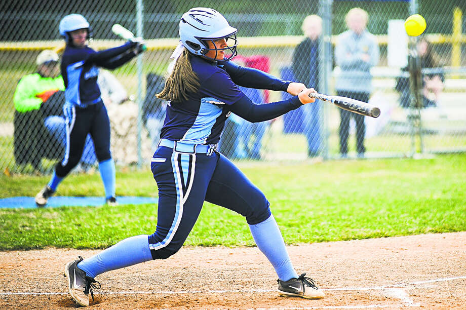 Meridian's Karley Kent takes a big cut during a game against Coleman earlier this season. On Monday, Kent homered twice and doubled once as the Mustangs earned a split with Unionville-Sebewaing. Photo: Katykildee/kildee@mdn.net