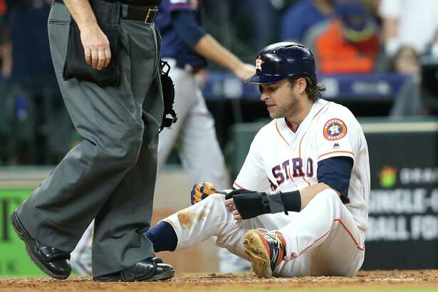 Houston Astros right fielder Josh Reddick (22) reacts after getting tagged out at home in the fourth inning against Minnesota Twins at Minute Maid Park on Monday, April 22, 2019.