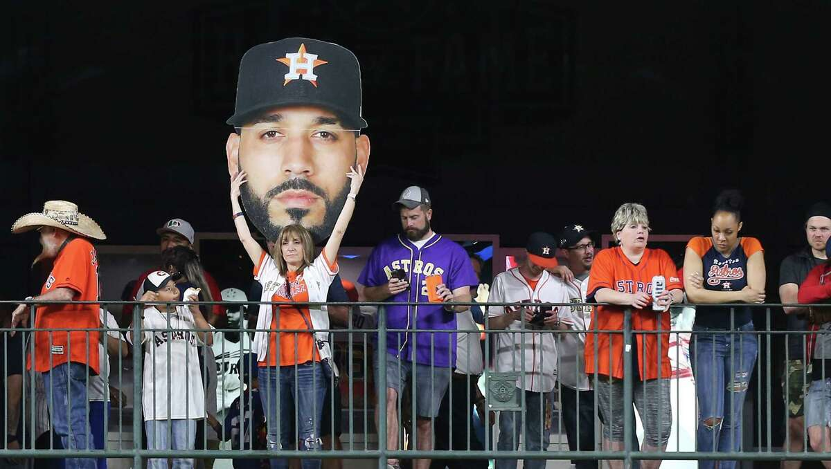 An Astros fan holds a giant head of Minnesota Twins third baseman Marwin Gonzalez (9) in an Astros hat at Minute Made Park on Monday, April 22, 2019.