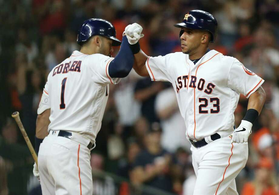 Houston Astros shortstop Carlos Correa (1) congratulates Michael Brantley (23) after Brantley's solo home run against Minnesota Twins at Minute Maid Park on Monday, April 22, 2019. Photo: Elizabeth Conley, Staff Photographer / © 2018 Houston Chronicle