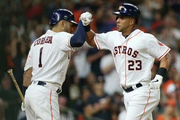 Houston Astros shortstop Carlos Correa (1) congratulates Michael Brantley (23) after Brantley's solo home run against Minnesota Twins at Minute Maid Park on Monday, April 22, 2019.