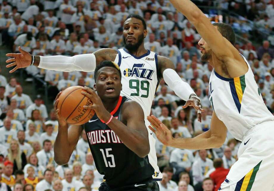 Utah Jazz's Jae Crowder (99) and Rudy Gobert, right, defend against Houston Rockets center Clint Capela (15) in the first half during Game 4 of a first-round NBA basketball playoff series Monday, April 22, 2019, in Salt Lake City. (AP Photo/Rick Bowmer) Photo: Rick Bowmer, Associated Press / Copyright 2019 The Associated Press. All rights reserved