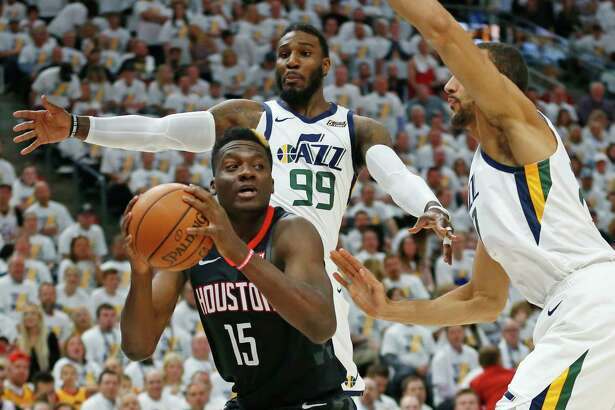 Utah Jazz's Jae Crowder (99) and Rudy Gobert, right, defend against Houston Rockets center Clint Capela (15) in the first half during Game 4 of a first-round NBA basketball playoff series Monday, April 22, 2019, in Salt Lake City. (AP Photo/Rick Bowmer)
