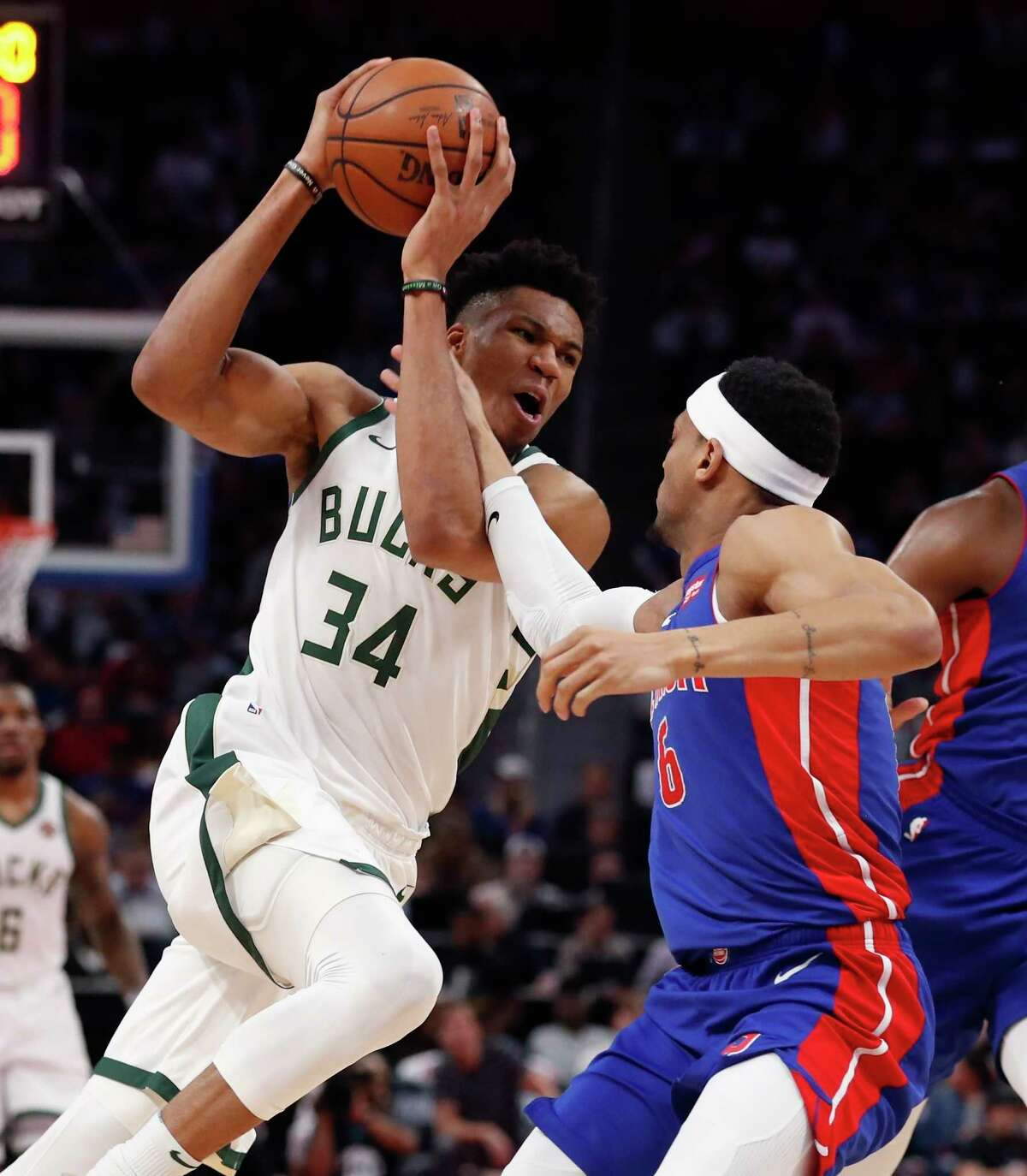Milwaukee Bucks forward Giannis Antetokounmpo (34) is fouled by Detroit Pistons guard Bruce Brown (6) during the first half of Game 4 of a first-round NBA basketball playoff series, Monday, April 22, 2019, in Detroit. (AP Photo/Carlos Osorio)