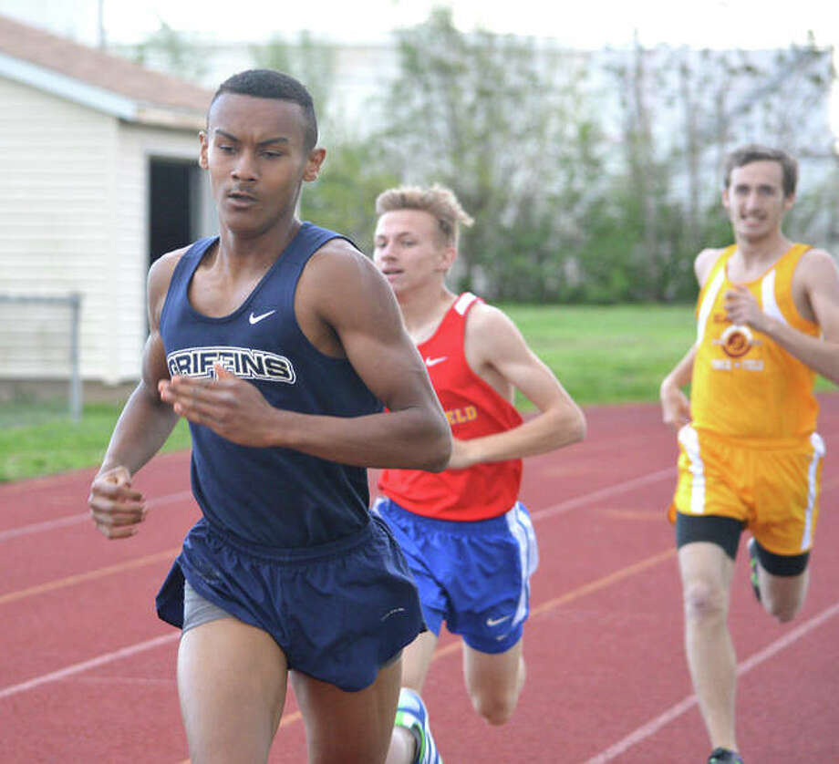 Father McGivney's Tyler Guthrie, left, is on his way to a first-place finish in the 800-meter run in Monday's Madison County Small School Meet at Roxana High School. Photo: Scott Marion/The Intelligencer