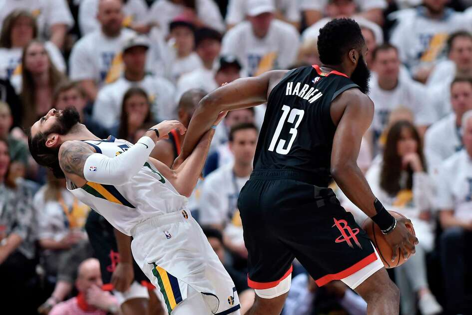 SALT LAKE CITY, UT - APRIL 22: Ricky Rubio #3 of the Utah Jazz is fouled by James Harden #13 of the Houston Rockets in the first half of Game Four during the first round of the 2019 NBA Western Conference Playoffs at Vivint Smart Home Arena on April 22, 2019 in Salt Lake City, Utah. NOTE TO USER: User expressly acknowledges and agrees that, by downloading and or using this photograph, User is consenting to the terms and conditions of the Getty Images License Agreement.