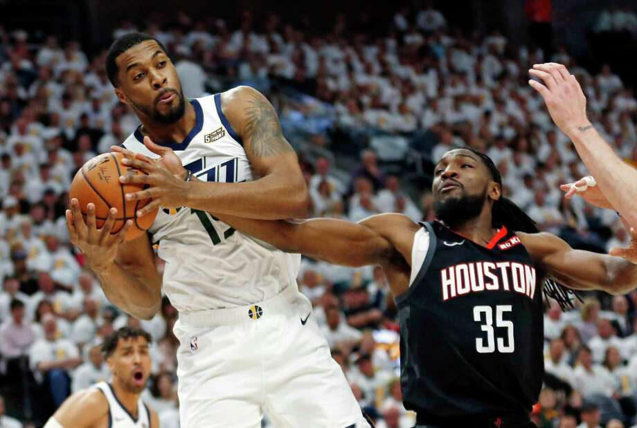 Utah Jazz forward Derrick Favors (15) grabs a rebound as Houston Rockets forward Kenneth Faried (35) defends in the first half during Game 4 of a first-round NBA basketball playoff series, Monday, April 22, 2019, in Salt Lake City. (AP Photo/Rick Bowmer) Photo: Rick Bowmer, Associated Press / Copyright 2019 The Associated Press. All rights reserved