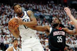 Utah Jazz forward Derrick Favors (15) grabs a rebound as Houston Rockets forward Kenneth Faried (35) defends in the first half during Game 4 of a first-round NBA basketball playoff series, Monday, April 22, 2019, in Salt Lake City. (AP Photo/Rick Bowmer)
