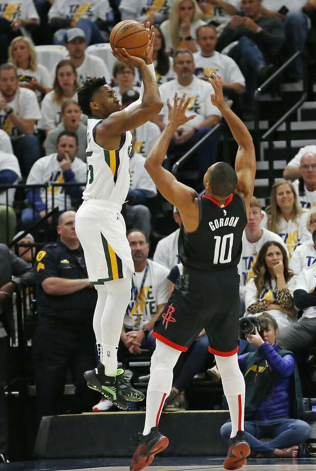 Utah guard Donovan Mitchell, shooting over Houston's Eric Gordon, scored 31 points in his team's Game 4 victory at home. Photo: Rick Bowmer / Associated Press