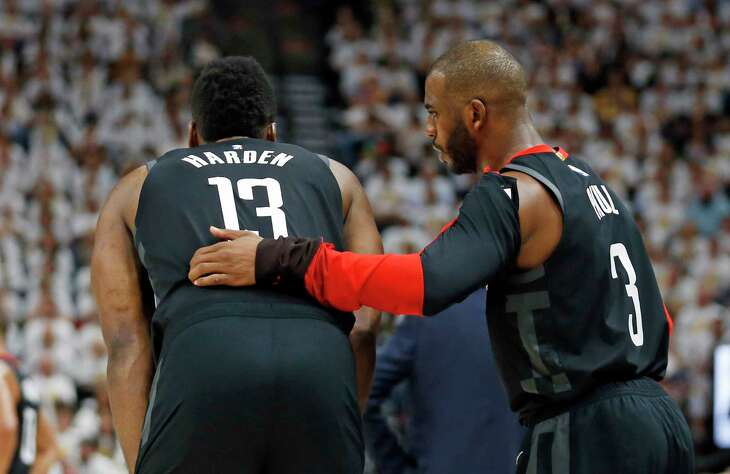 Houston Rockets' Chris Paul (3) speaks with James Harden (13) in the second half during Game 4 of a first-round NBA basketball playoff series against the Utah Jazz, Monday, April 22, 2019, in Salt Lake City. (AP Photo/Rick Bowmer)