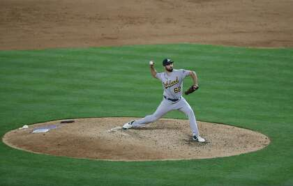A's reliever Lou Trivino unavailable with thumb injury