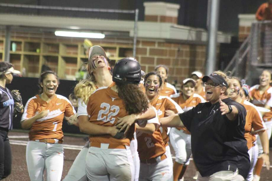 With outstretched arms, Dobie softball head coach Robin Rackley is among the first to reach Karlie Barba after Barba laced a walk-off double that fell inches fair down the left-field line, handing the Horns a 5-4 win and the No. 2 seed. Photo: Robert Avery