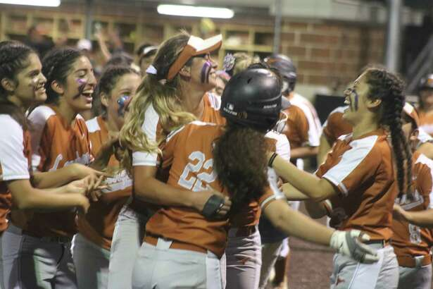 More Dobie players mob Karlie Barba (22) after her dramatic game-winning hit Monday night at Humble High School.