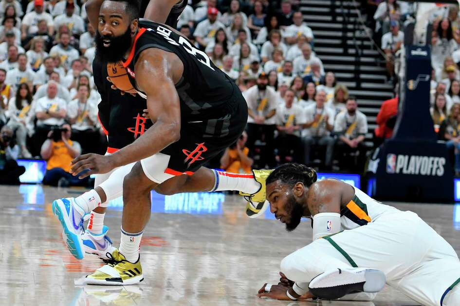 SALT LAKE CITY, UT - APRIL 22: James Harden #13 of the Houston Rockets gets past Jae Crowder #99 of the Utah Jazz in the second half of Game Four during the first round of the 2019 NBA Western Conference Playoffs at Vivint Smart Home Arena on April 22, 2019 in Salt Lake City, Utah. NOTE TO USER: User expressly acknowledges and agrees that, by downloading and or using this photograph, User is consenting to the terms and conditions of the Getty Images License Agreement.