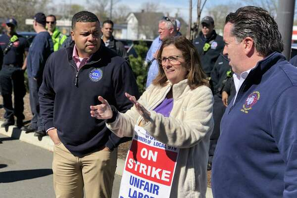 New Haven police and firefighters came out to stand with striking Stop & Shop workers at the store's Whalley Avenue location Wednesday.