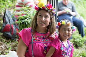 Fiesta goers grabbed their spots along the River Walk for the Texas Cavaliers River Parade.