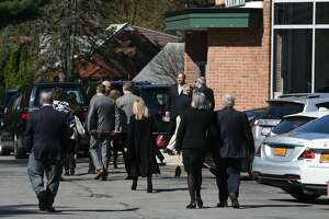 Mourners arrive at Congregation Gates of Heaven synagogue in Schenectady Tuesday morning to pay respects to local educator, businesswoman and philanthropist Jane Golub.