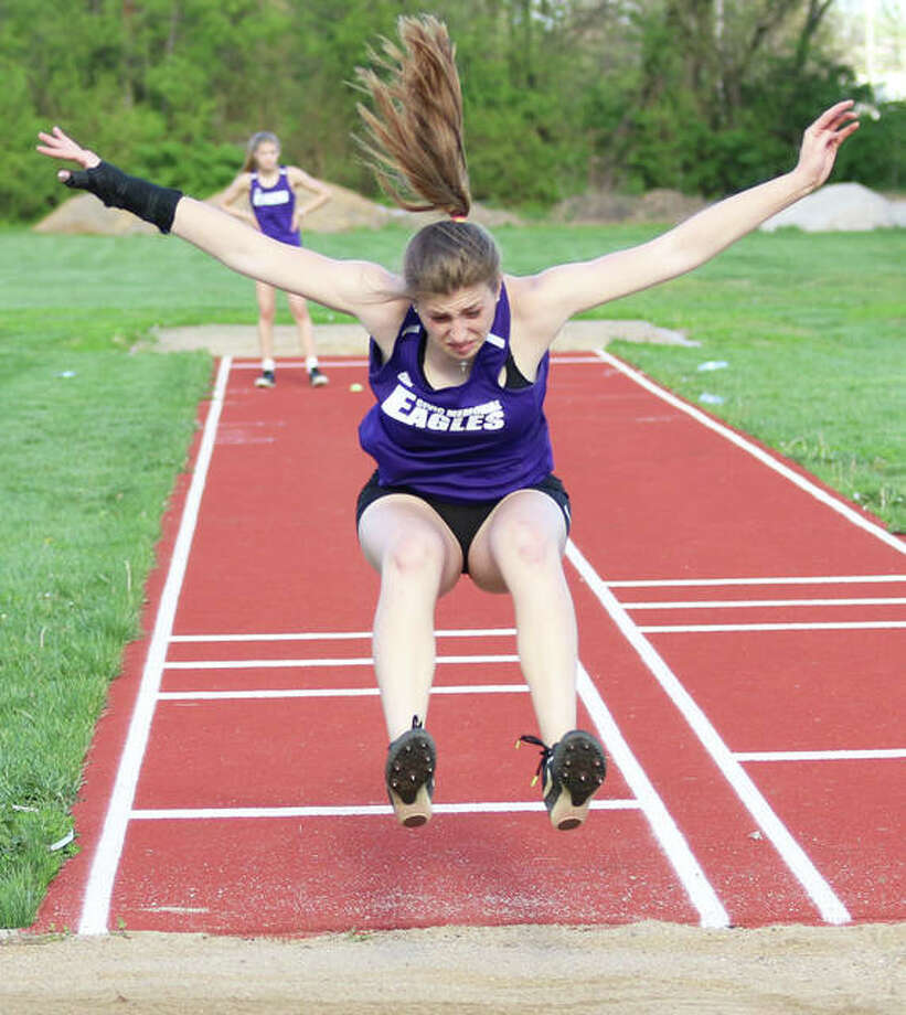 CM's Jackie Woelfel finishes off her triple jump Monday at the Madison County small-schools girls track meet in Roxana. Woelfel placed second with a leap of 30 feet, 9 inches. Photo: Greg Shashack / The Telegraph