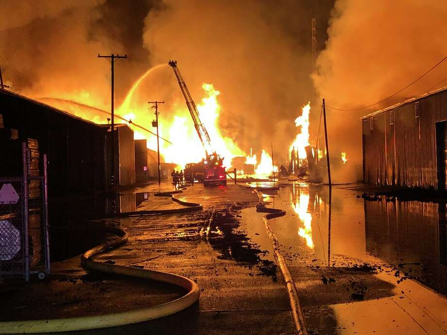 A six-alarm fire consumed a pallet and lumber business on West Scotts Avenue in Stockton Tuesday morning. Photo: Brian Hickey / KCRA