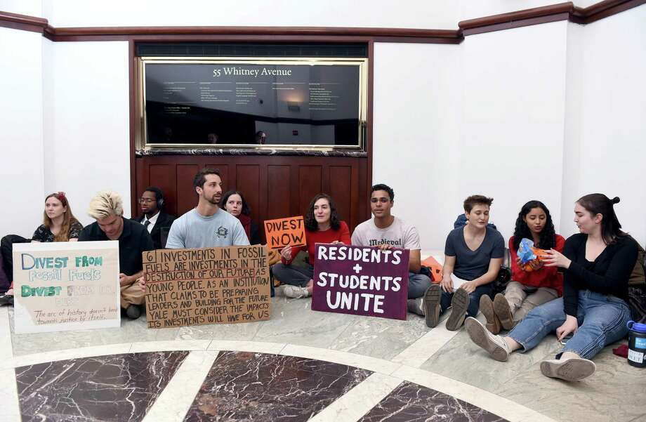 Yale University students occupy the lobby of the building on Whitney Avenue in New Haven housing the Yale Investments office on April 2, 2019. Protesters seek to have the Yale University endowment divest of Puerto Rican debt and investments in the fossil fuel industry. Photo: Arnold Gold / Hearst Connecticut Media / New Haven Register