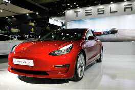 A Tesla Model 3 electric vehicle on display at the Seoul Motor Show on March 28, 2019.