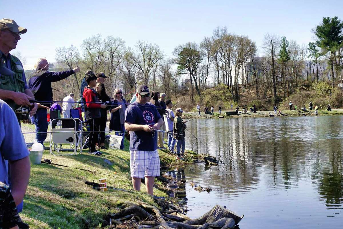 Children and adults fish at Rensselaer Lake at Six Mile Waterworks located in the Albany Pine Bush Preserve, during a New York State Department of Environmental Conservation's I FISH NY Program on Tuesday, April 23, 2019, in Albany, N.Y. The DEC also stocked the lake on Tuesday with more than 1,000 catchable-size rainbow trout. (Paul Buckowski/Times Union)