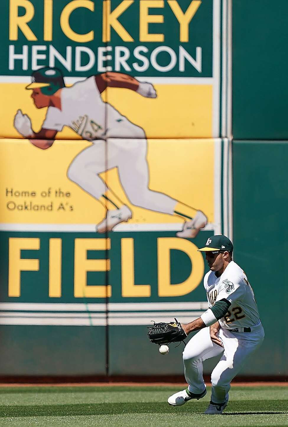 Ramon Laureano #22 of the Oakland Athletics plays the ball on a hop for a base hit off the bat of Brandon Drury of the Toronto Blue Jays in the top of the six inning of a Major League Baseball game at Oakland-Alameda County Coliseum on April 21, 2019 in Oakland, California.