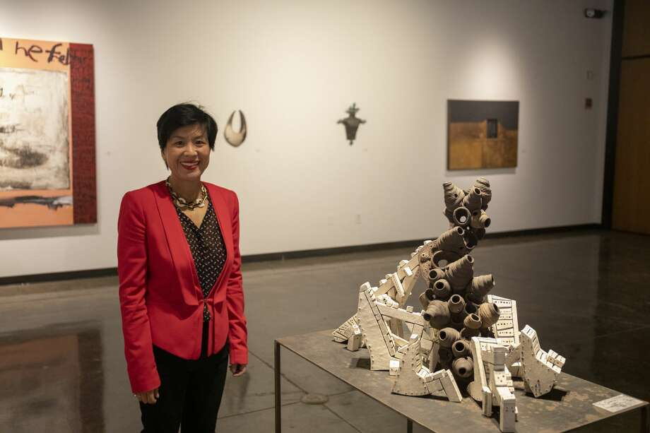 Amy Kim poses at the Nancy Fyfe Cardozier Gallery with pieces from the exhibit 'Transference.' Photo: Jacy Lewis/191 News
