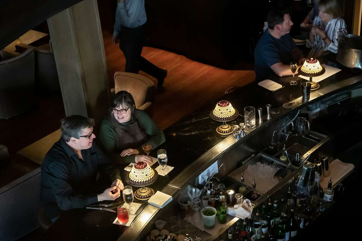 Lamps line the semi-circle bar at Jardini�re French Restaurant on Sunday, April 21, 2019, in San Francisco, Calif.