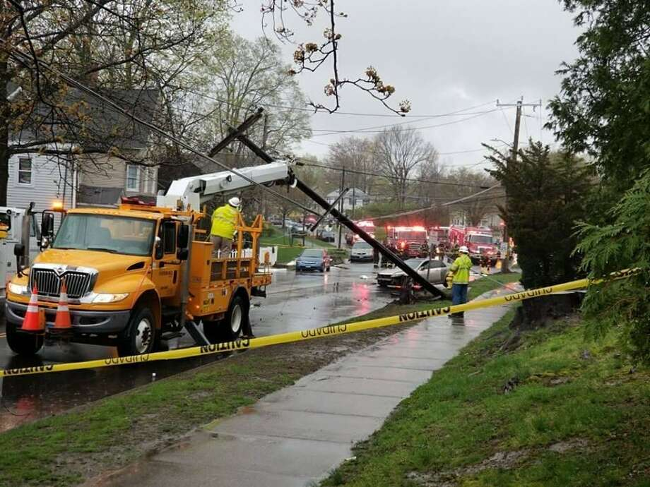 Emergency personnel at the scene of an accident April 22, 2019, where a car crashed into a telephone pole on Franklin Street. Photo: Danbury Fire Department / Facebook