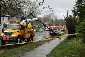 Emergency personnel at the scene of an accident April 22, 2019, where a car crashed into a telephone pole on Franklin Street.
