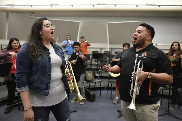 Marla Gutierrez, left, and Augustine Ortiz sing during a rehearsal by members of the UTSA Los Paisanos Mariachi Ensemble at UTSA.