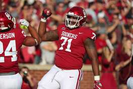 NORMAN, OK - NOVEMBER 25: Oklahoma Sooners OL Bobby Evans (71) celebrates after a touchdown during a college football game between the Oklahoma Sooners and the West Virginia Mountaineers on November 25, 2017, at Memorial Stadium in Norman, OK. (Photo by David Stacy/Icon Sportswire via Getty Images)