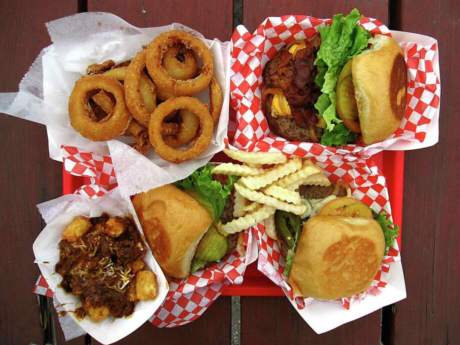 Burgers and sides at Papa's Burgers include onion rings, the triple-meat Jack Burton Burger, El Caliente Burger with jalapenos and pepperjack cheese, crinkle-cut fries, a basic Papa's Cheeseburger and chili-cheese tater tots. Photo: Mike Sutter /Staff File Photo