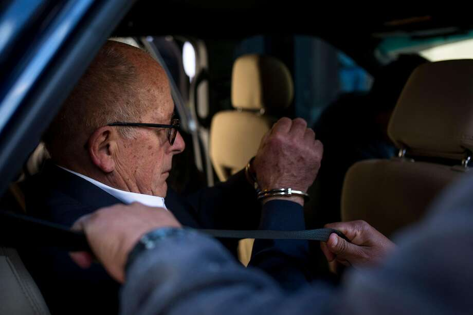 Laurence Doud, former chief executive at Rochester Drug Cooperative, is escorted in handcuffs into a car from a Drug Enforcement Administration office in Manhattan, after turning himself in, April 23, 2019. The company, which is the nation's sixth-largest pharmaceutical distributor, was charged on Tuesday with conspiring to distribute drugs and defrauding the federal government. Doud and one other former company official were also charged in the case, which was brought by the U.S. attorney's office in Manhattan. (Dave Sanders/The New York Times) Photo: Dave Sanders, NYT