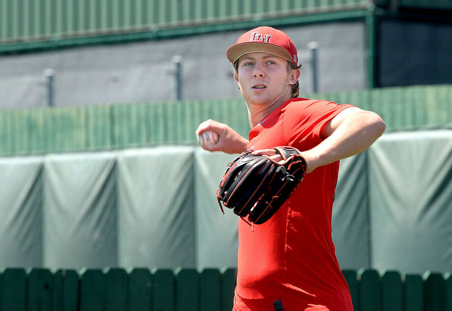 West Orange - Stark graduate Jack Dallas throws as he and members of the Lamar's pitching crew practice. Dallas, who was a redshirt with the football team this season, is one of two dual-sport athletes playing for the Cardinals. Freshman Kirkland Banks also plays for the football team and is a redshirt freshman for baseball. Photo taken Thursday, April 19, 2018 Kim Brent/The Enterprise Photo: Kim Brent