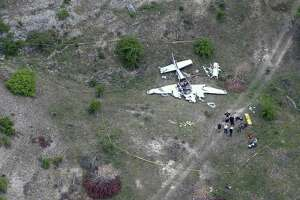 The wreckage of a twin-engine Beechcraft BE58 is seen Monday in an aerial image. All six people on the plane were killed in the crash that occurred about 6 miles northwest of the Kerrville Municipal Airport about 9 a.m. Monday.
