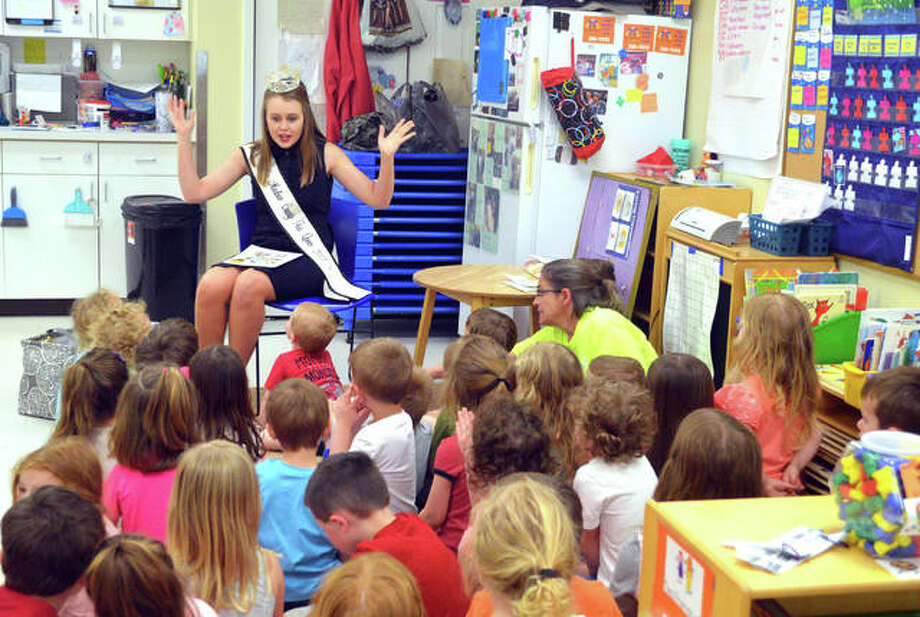 Preschoolers listen as Missy Huddleston, Miss Madison County Fair 2018, reads a story on Monday afternoon at Early Explorations Too in Glen Carbon. Photo: Scott Marion | The Intelligencer