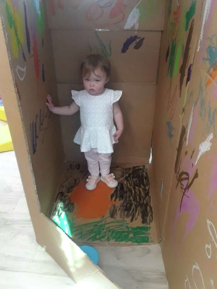 Ellie Erk, 1, hangs out in a playhouse made of decorated cardboard boxes at The Goddard School, 288 Monroe Turnpike, Monroe on April 23, 2019. All month long, students are doing eco-friendly activities in honor of Earth Day and Arbor Day, both of which are in April. Photo: Amanda Cuda / Hearst Connecticut Media