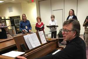 "Eric Dale Knapp, director of the Connecticut Choral Society, leads a rehearsal for the group's ""Bernstein @100"" concert, to be held at Trinity Episcopal Church in Newtown on May 4, and at North Congregational Church in Woodbury on May 5."