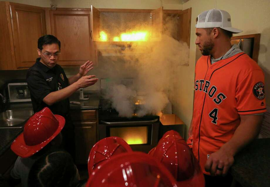 PHOTOS: More from George Springer's appearance at Law Elementary School Houston Fire Department community liaison Francis Tran, left, talks to Law Elementary School students on what to do in case of a fire during a fire and smoke demonstration during Fire Safety Day Tuesday, April 23, 2019, in Houston. Houston Astros outfielder George Springer joined The Hartford and the Houston Fire Department at the elementary school for a hands-on fire safety day for children in kindergarten through second grade. More than 200 students were deputized as junior fire marshals. Photo: Godofredo A Vásquez, Staff Photographer / © 2019 Houston Chronicle