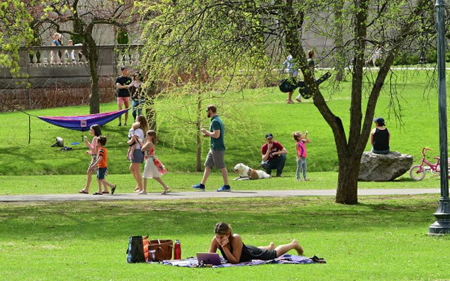 Congress Park is bustling with people enjoying the warm weather on Tuesday, April 23, 2019 in Saratoga Springs, N.Y. (Lori Van Buren/Times Union) Photo: Lori Van Buren, Albany Times Union