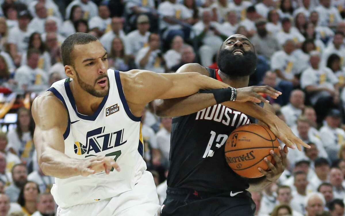 Jazz center Rudy Gobert, left, was rough on James Harden and the Rockets during the two games in Salt Lake City as Utah clamped down defensively.