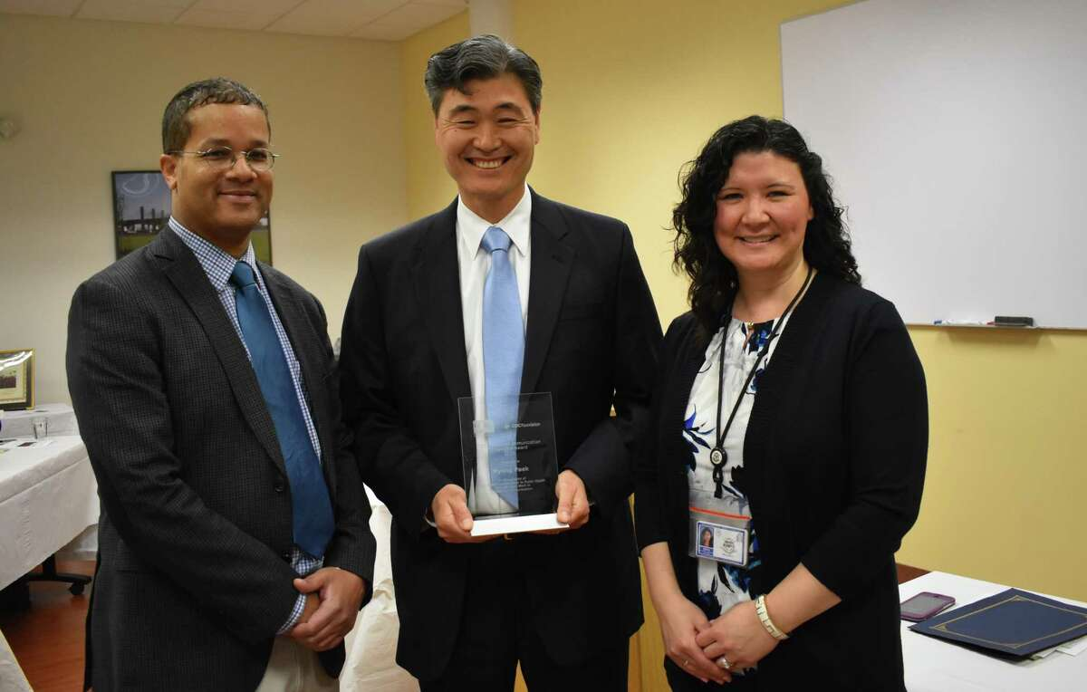 From left, Dr. ByronKennedy, New Haven health director; Dr.Hyung Paek, medical director of information technology, Yale New Haven Health System and Fair Haven Community Health Care; andNancySharova, health program supervisor, state Department of Public Health Immunization Program. Paek received an award from the Centers for Disease Control and Prevention for creating an electronic immunization record system.