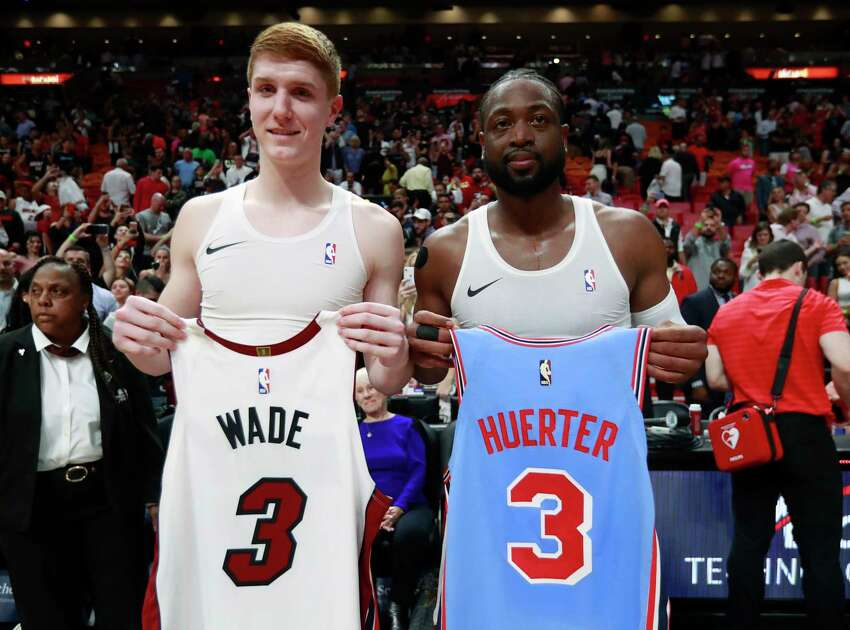 Miami Heat guard Dwyane Wade, right, and Atlanta Hawks guard Kevin Huerter swap jerseys after an NBA basketball game, Monday, March 4, 2019, in Miami.