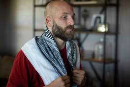 Michael Behenna wears a scarf he brought home from Iraq at his farm near Guthrie, Okla., where he has been living since his parole from military prison.