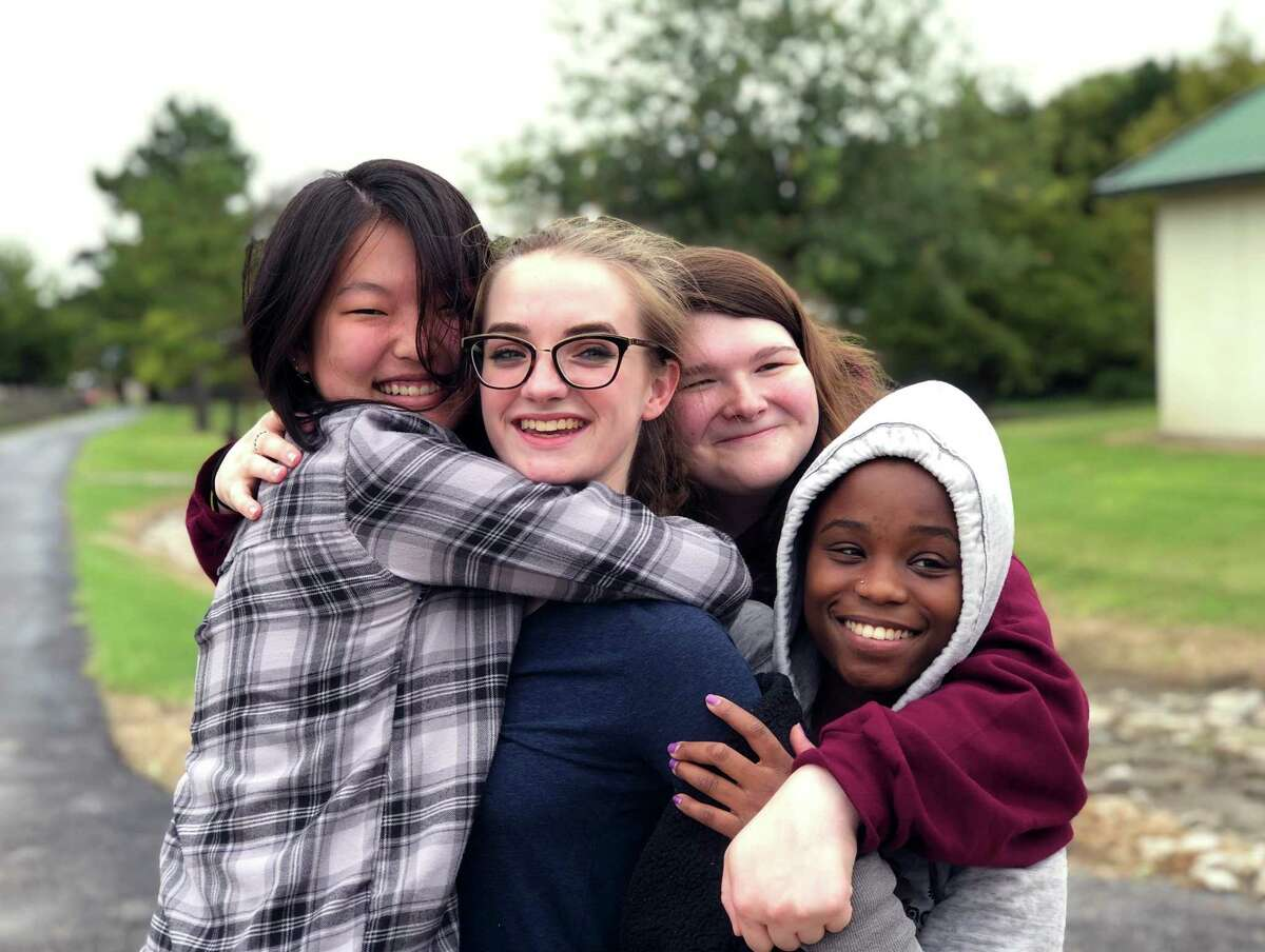 Students from Gateway Academy embrace and smile for the camera at Camp for All. The camp is just one of the many programs the school offers for middle and high school students with learning and social differences.