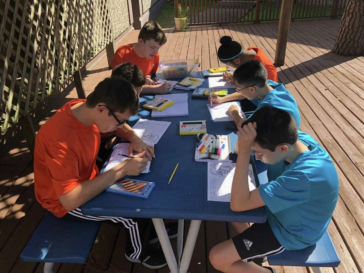 Gateway Academy educates middle and high school students with learning and social differences to mold them into independent, contributing members of society. Here, students complete assignments for science class.